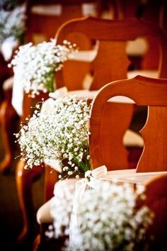 Brit what about this in the paper cones on the aisles of the church? But off white baby's breath with burgundy ribbons??? <3 it!!