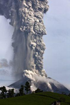 Nov. 14, 2013. Mount Sinabung spews pyroclastic smoke as seen from Tigapancur village in Karo district in Medan, Sumatra, Indonesia.