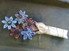 handmade primitive fabric flower with vintage button center and apple branch stems