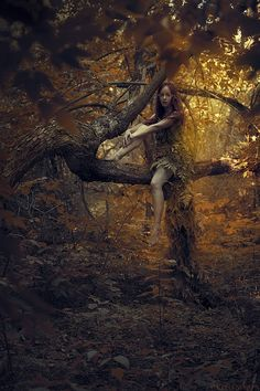 The girl blended with the forest, as if she were a walking stick on a tree branch. Is she a creature of the forest or a cleverly diguised nymph from another dimension ?
