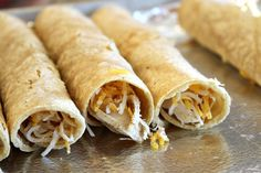 Baked Chicken Taquitos from Recipe Girl.  They have advice on when to stop and freeze them, so they would be good to have for a busy night.  And they're baked, not fried.