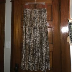 Cheetah print maxi. NWOT Never worn cheetah print maxi with elastic belt attached. Approx 37in from belt to hem. Size 2x. Skirts Maxi