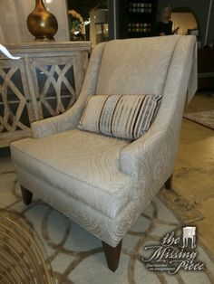 Ethan Allen sloped arm accent chair in a print cream on cream. Retails currently at Ethan Allen for $1,110. Measures 30*30*38. Sorry, just one.