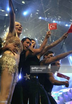 Turkey's Sibel Tuzun with her band celebrates on stage after her qualification to the finals during the semi-final of the 51st Eurovision song contest at the Indoor Olympic Hall in Athens 18 May 2006. AFP PHOTO/ Aris MESSINIS.