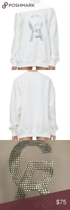 Good American The Crystal Icon Pullover (Flaw) Authentic NEW, never worn. Hang Tags included.  Flaw: Spots/Dirt on back, see photo. SOLD AS IS  🔵 YES I Bundle 🔴 NO I don't trade (I'm a recovering hoarder trying to clean out my closet) 🔵 I accept reasonable offers 🔴 NO low ball offers please 🔵 Please Use the Offer Button!    💜 Thank you for visiting my closet! Good American Tops Sweatshirts & Hoodies