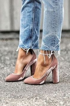 Spotted on the streets of New York, London, Milan and Paris, fur and feather shoes are everywhere this season. We love this street style look with distressed frayed jeans with mauve velvet pumps