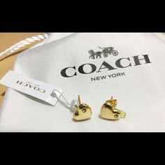 Coach Pave Sculpted Heart Stud Earrings Brand  100% authentic Coach Pave Sculpted Heart Stud Earrings- Gold plated brass. True objects of affection, these polished heart earrings are beautifully plated in precious metal and adorned with shimmering crystals. One is finished with a petite Coach hangtag charm for a touch of signature style. Includes: a white Coach pouch and jewelry care booklet. Fast Shipping  Coach Jewelry Earrings
