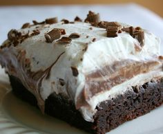 Brownie Refrigerator Cake....2 brownie mixes  1 extra large egg  1 (8 oz.) package cream cheese, softened  1 cup powdered sugar  2 (8 oz.) containers whipped topping  1 (3 oz.) package instant chocolate pudding  1 (3 oz.) package instant vanilla pudding  3 1/2 cups milk  1 Hershey candy bar or chocolate syrup..