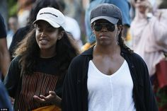 The Obamas (Michelle and Malia pictured) flew into the popular tourist destination on Frid...