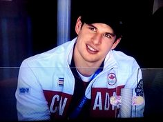 Sidney Crosby watching the Canadian women's hockey team play #Sochi2014. I love that crooked smile.