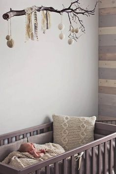 7 Creative Nursery Trends - This rustic accessory instantly updates the space from simple to stunning. Parents hoping to achieve a similar look don't have to travel too far, just pop into your backyard and find a beautiful branch to make into a mobile. Nursery Room, Girl Nursery, Kids Bedroom, Nursery Mobiles, Nursery Crafts, Diy Nursery Decor, Boy Room, Nursery Neutral, Nursery Grey