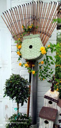 Birdhouse rake by the garage http://ourfairfieldhomeandgarden.com/diy-project-repurposed-rakes/