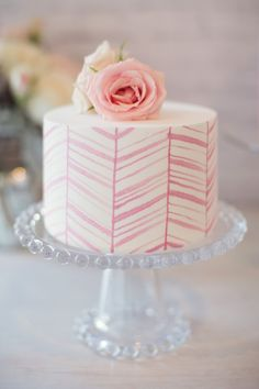 This cute white one with lovely pink chevrons. | 24 Spectacular One-Tier Wedding Cakes