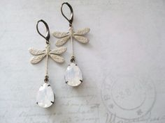Items similar to Dragonfly Earrings / Romantic Jewellery / Swarovski White opal / Garden Wedding / DragonflyEarrings / Gifts for Her / Kathco Jewellery on Etsy White Opal, Garden Wedding, Antique Brass, Gift Guide, Festive, Gifts For Her, Swarovski, Romantic, Nude
