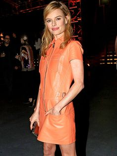 Kate Bosworth brings holiday cheer in a melon leather dress at Thursday's Coach Backstage Rodeo Drive event in Beverly Hills. (dec 2014)