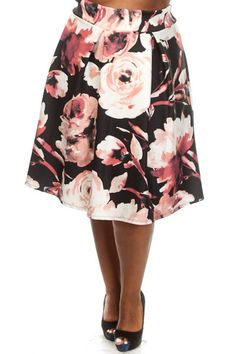 This cute plus size skirt features a floral print body, flared bottom, and a knee length fit. Soft, stretch material Loose fit Model wearing 3X Made in USA