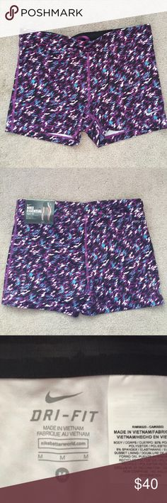 NWT size medium Nike tight-fit essential shorts New with tags Nike women's size medium tight-fit essential shorts. Shorts have a little zippered pocket on the back for keys or other small items Nike Shorts