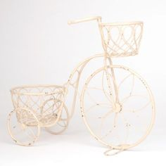 Give your patio a quaint, vintage makeover with this Distressed Bicycle Planter. With space for two small pots, this planter will roll your patio into Spring! #kirklands #SpringisintheAir
