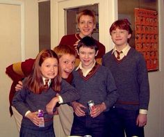 Fred, George, Ron and Ginny Weasley and Seamus Finmegan