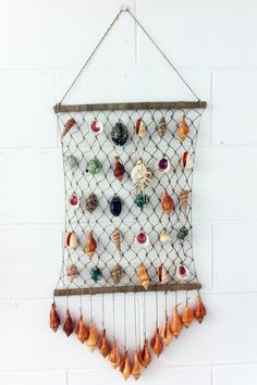 18 extremely easy diy seashell decoration ideas | wall hangings