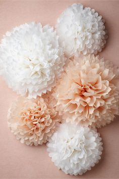 We love paper puffs! They're a fun and festive #wedding decor idea. Check these from @BHLDN