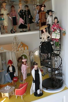 I had one barbie and made my own clothes for her, and made a house out of planks from a scrap pile and painted it with several colors of paint all mixed together, a pukey aqua color and this is what i imagined my doll house looked like