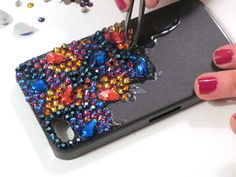 Accessorizing your iPhone with the perfect glamorized case has become the latest fashion obsession. Today, you will learn how to embellish you own iPhone case. Bling Phone Cases, Iphone Phone Cases, Iphone 8, Diy Case, Diy Phone Case, Iphone Hacks, Cell Phone Covers, Tablets, Diy Crystals