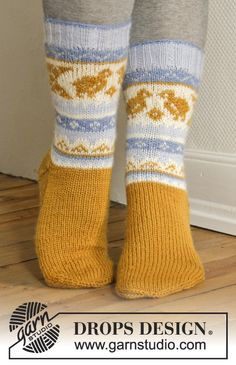 Happy and colourful #Easter socks with Norwegian pattern. #FreePattern by #DROPSDesign