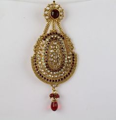 Jhoomar(Passa) is a fan shape hair ornament worn on the left side of the hair.