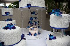 water fountain under the royal blue wedding cake decorated with white chocolate…