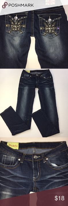 """Machine dark wash skinny leg denim jeans size 3 27 Charlotte Russe Machine dark wash distressed skinny leg 5 pocket denim jeans, size 3/27. Jeweled button closure and zipper. Back pocket bling. Measures approximately 15"""" waist, 16.5"""" hips, 7"""" rise, 5.5"""" ankle cuff width, 32"""" inseam, 41"""" length. Smoke free home. (A32) Machine Jeans Skinny"""