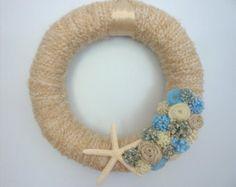 Summer beach yarn wreath with starfish in shades of cream, tan and blue.