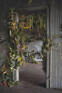 Pin for Later: Thousands of Flowers Turn This Abandoned House Into a Fairy-Tale Work of Art A decrepit doorway is dripping with lively flowers. Deco Floral, Arte Floral, Flower Installation, Wall Installation, Wedding Flower Decorations, Abandoned Houses, Abandoned Detroit, Ikebana, Flower Art