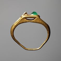 Finger ring with inserted stones. Roman, 200-400  Gold, emerald, diamond.