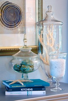 Display items in your home that remind you of the places you have been and the memories you have made. Do you love the seaside? Artfully display your beach finds in glass cloches, jars and vases.