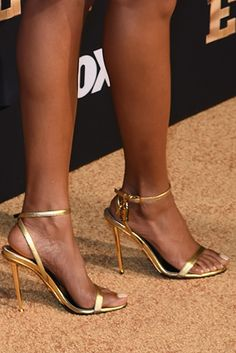 TARAJI P. HENSON'S SHOE GAME IS SO MEAN! TARAJI'S SHOE GAME These gold Tom Ford sandals are the perfect wardrobe staple. By Dominique Hobdy