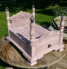 Dog bed made from an old end table! Check us out at Www.facebook.com/turnedoutfurniture