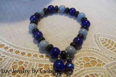 black, blue, and grey beaded bracelet