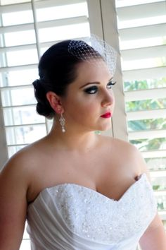Wedding makeup: red lips, smokey eye. Wedding hair: updo. View more from this black and red wedding: http://www.pinterest.com/nyxchamp/my-black-red-wedding/