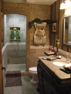 A door-less walk in shower that can be done in small spaces. Have to remember this!