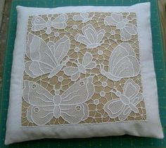 FSL... This freestanding lace machine embroidery decoration consists of 8 FS lace butterfly embroidery designs. The parts are combined together to produce a lace square approximately 30 x 30 cm (11.5 x 11.5 inches).   My pillow is 15x15