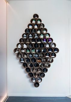 Fun and sculptural shoe storage made from cardboard tubes gathered in a diamond shape with straps.