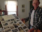 Albert Mason holds up photos of his older brother, Cpl. George Mason, who has been missing in North Korea since 1951. After more than six decades missing, the Army has identified Cpl. George Mason's remains and is bringing them home.