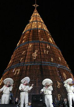 THE WORLD'S TALLEST ARTIFICIAL CHRISTMAS TREE IS ON REFORMA AVENUE IN MEXICO CITY…..THE 110-METRE-HIGH TREE WAS OFFICIALLY RECOGNISED BY GUINNESS WORLD RECORDS EARLIER THIS MONTH. IT IS COVERED IN 1.2 MILLION LIGHTS, USING 80 KILOMETRES OF CABLING.