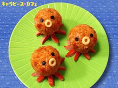 Octopus chicken rice onigiri...just a picture, but it would be simple to make. Rice ball with cut sausage underneath.