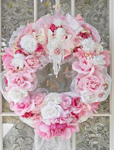 Pink Victorian Cherub Wreath.  Decorated in high Princess style with tons of dripping pearls, vintage millinery flowers and jewels.