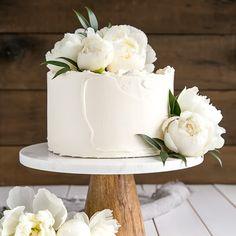 This Lemon Elderflower Cake is a copycat version of the royal wedding cake! Elderflower infused lemon cake layers with lemon curd and elderflower buttercream.