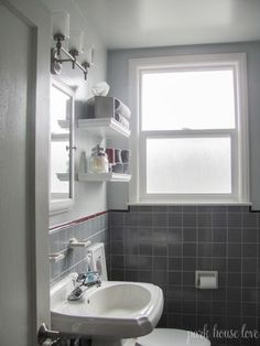 Skinny glass tile accent wall in bathroom for the home for Red accent bathroom