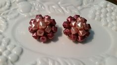 Check out this item in my Etsy shop https://www.etsy.com/listing/233560924/vintage-cluster-bead-clip-earrings
