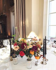 Can't go wrong with persimmons and moody black taper candles! As seen at this weekend's amazing fall wedding at Congressional Country Club   #wildgreenyonder #centerpiece #flowers #fruit #weddingflowers #marylandflorist #marylandweddingvenue #reception #tabletop #fallwedding